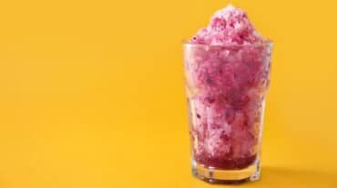 Beat the summer heat with this low-cal pomegranate and strawberry slush